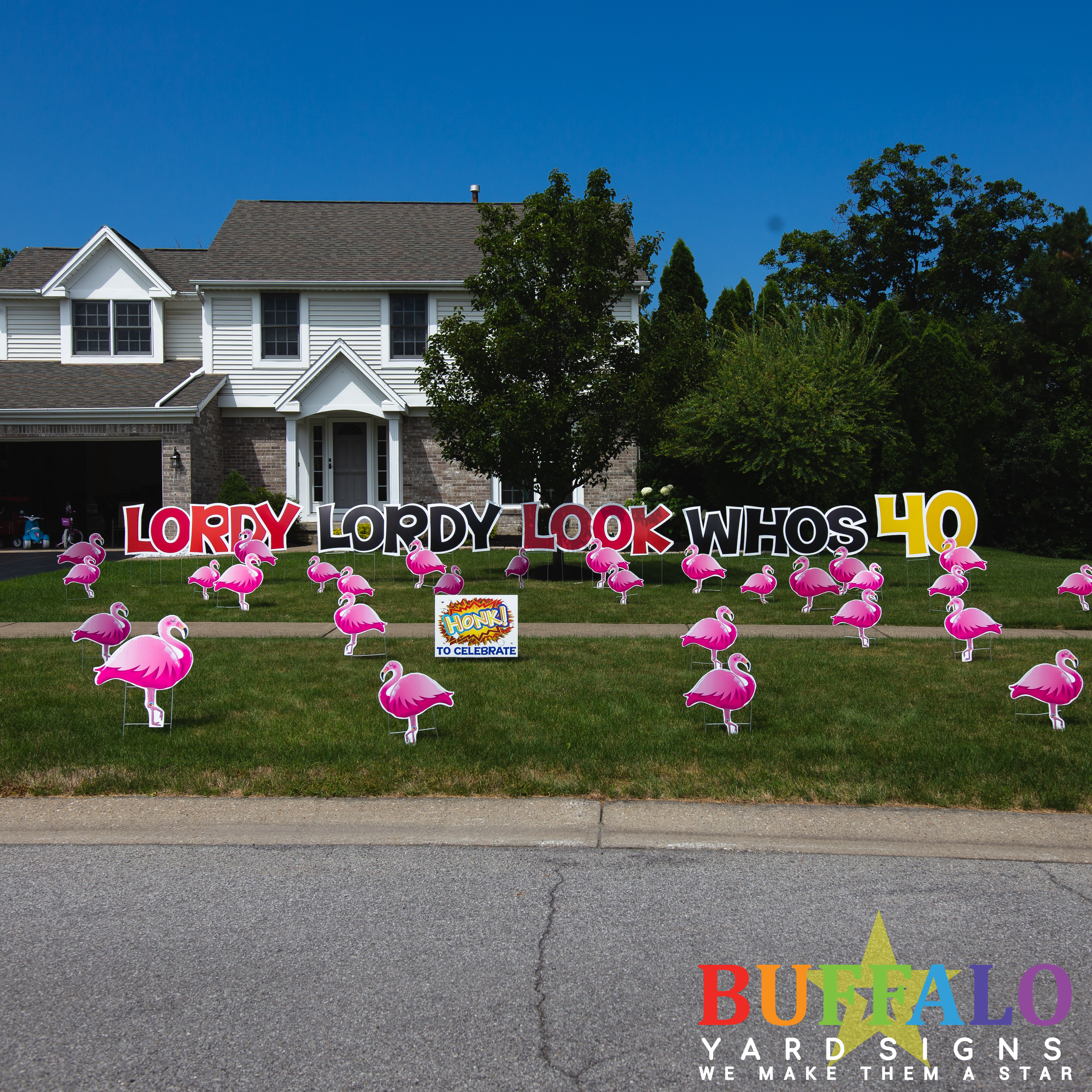 Flamingo flock with custom yard sign that says Lordy Lordy Look Whos 40