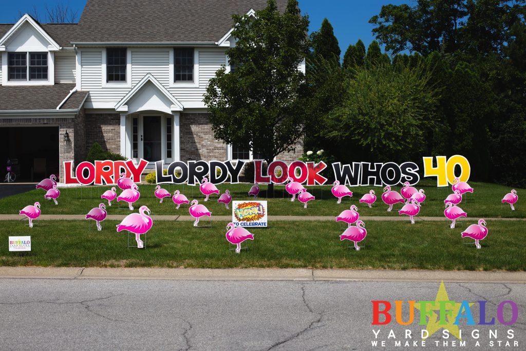 Flamingo Flock with birthday yard sign from Buffalo Yard Signs